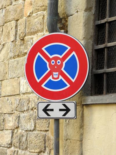 "Street sign by Clet Abraham in ""Via della Venezia"""